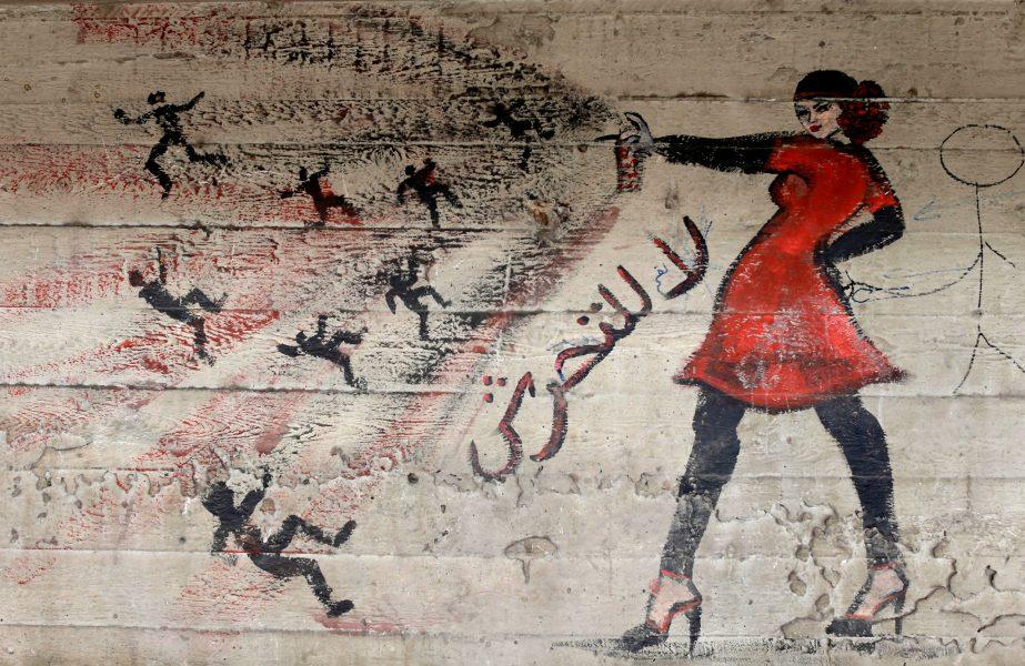"Hassan Ammar/AP Photo/TT | Målning i kairo, Egypten, med texten ""Stoppa sextrakasserierna""."